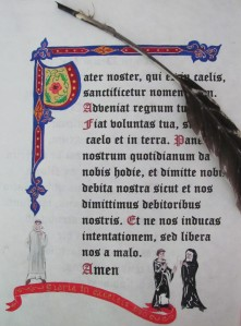 The Lord's prayer in latin. Black ink and decorationr