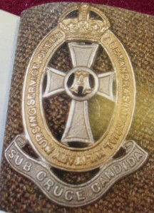 Lapel badge for regular QAIMNS showing the cross and motto